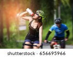 cyclists woman drinking water... | Shutterstock . vector #656695966