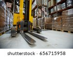 forklift truck in aisle between ... | Shutterstock . vector #656715958
