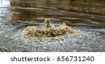water flows out of road sewage... | Shutterstock . vector #656731240