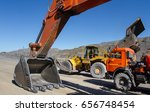 Small photo of Excavator and trucks in his career. mining equipment. Mining