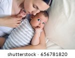 mom with a newborn son lying on ... | Shutterstock . vector #656781820