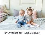 two infant baby posing in bib   Shutterstock . vector #656785684