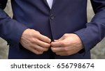 the man fastens buttons on his... | Shutterstock . vector #656798674