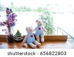 two teddy bear sitting on a... | Shutterstock . vector #656822803
