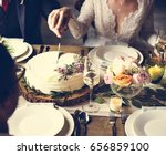 bride and groom cutting cake on ... | Shutterstock . vector #656859100