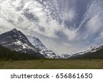 Distant Landscape View of Snowy Mountain Robson Top and Dramatic Chinook Sky Clouds in Jasper National Park Rocky Mountains Alberta Canada
