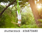 beautiful girl practicing fly... | Shutterstock . vector #656870680