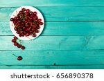 cherries on a white plate on a... | Shutterstock . vector #656890378