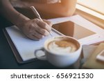 hot latte coffee cup on table | Shutterstock . vector #656921530