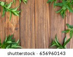 mint leaves on a wooden... | Shutterstock . vector #656960143