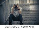 depressed businessman sitting... | Shutterstock . vector #656967919