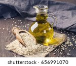 sesame oil in glass and seeds | Shutterstock . vector #656991070
