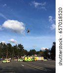 Small photo of Hampshire Air Ambulance Helicopter at Fleet Services M3 April 2017 Landing Taking Off Emergency
