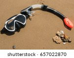a snorkeling mask on the wet... | Shutterstock . vector #657022870