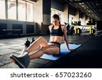female athlete trains press in... | Shutterstock . vector #657023260