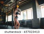 female athlete drink water... | Shutterstock . vector #657023413
