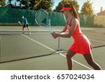 couple playing tennis on... | Shutterstock . vector #657024034