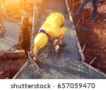 man hand spreading concrete mix ... | Shutterstock . vector #657059470