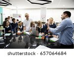 Small photo of High school students studying in chemistry laboratory experiment class
