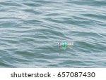 bottle in the ocean  plastic... | Shutterstock . vector #657087430