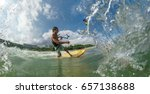 a kite surfer rides the waves | Shutterstock . vector #657138688