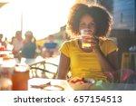 Cheerful Girl Sitting In A Bar  ...