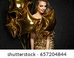 beautiful blonde woman on black ... | Shutterstock . vector #657204844