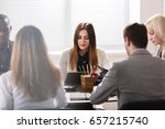 smiling young female manager... | Shutterstock . vector #657215740