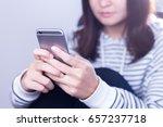 woman using smart phone | Shutterstock . vector #657237718