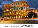 Colosseum And Traffic Lights A...