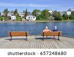 Two elderly women sitting on the wooden bench in boardwalk