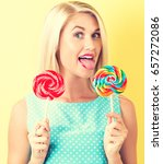 young woman holding lollipops... | Shutterstock . vector #657272086