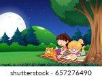 girls reading book in garden at ... | Shutterstock .eps vector #657276490