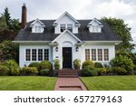 classic white clapboard house... | Shutterstock . vector #657279163