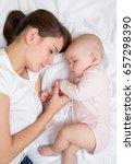 mother and baby newborn sleep...   Shutterstock . vector #657298390