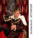 old funny king getting drunk... | Shutterstock . vector #657340189