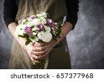 woman holding flower bouquet | Shutterstock . vector #657377968