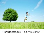 japanese child play on the field | Shutterstock . vector #657418540