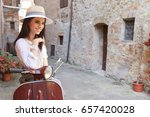 beautiful girl in a hat in a... | Shutterstock . vector #657420028