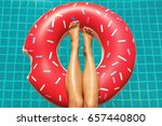 female legs and inflatable swim ... | Shutterstock . vector #657440800