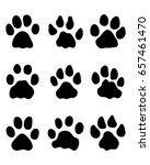 black footprints of lions on a... | Shutterstock .eps vector #657461470