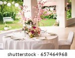 wedding table in the garden | Shutterstock . vector #657464968