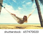 woman relaxing at the beach on... | Shutterstock . vector #657470020