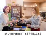 shopping woman paying with... | Shutterstock . vector #657481168