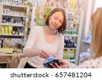 shopping woman paying with... | Shutterstock . vector #657481204