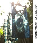 Small photo of Bring indigo dyed cloth to dry after washing with water.