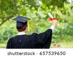 man hand holding diploma with a ... | Shutterstock . vector #657539650