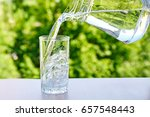 clean drinking water is poured... | Shutterstock . vector #657548443