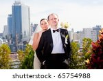 portrait of newlyweds against the backdrop of the city - stock photo