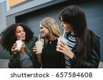 shot of three young women... | Shutterstock . vector #657584608